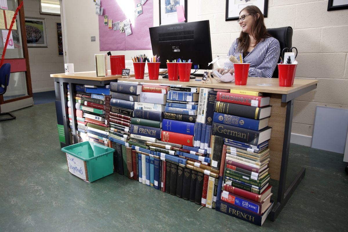 Loreot Book Drive: Emma Clair Clarke behidn the desk in the revamped library